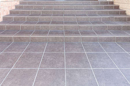 Granite tiled stairs around the walkway up the office building