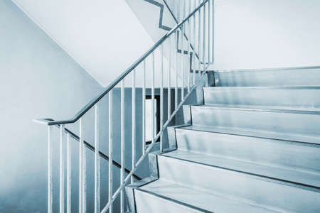 Concrete staircase with metallic handrail at modern buiding