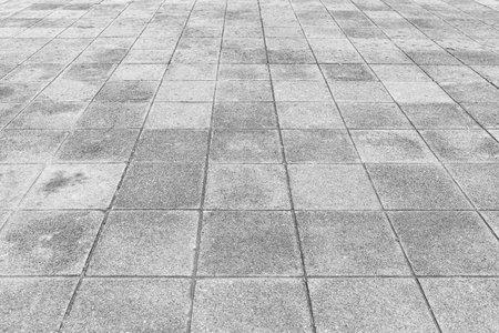 Perspective View Monotone Gray Brick Stone Pavement on The Ground for Street Road Archivio Fotografico