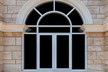 European white aluminum window frame and brown stone wall Banque d'images