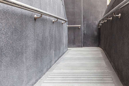 Cement stairway up the building for wheelchair Banco de Imagens