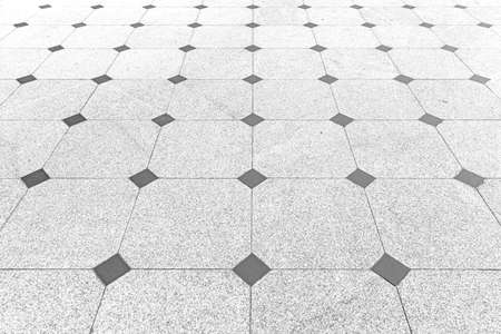 Perspective View Monotone Gray Brick Stone Pavement on The Ground for Street Road Stockfoto