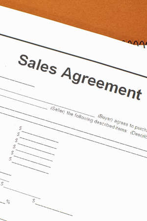Sale agreement document closeup for use in a business concept