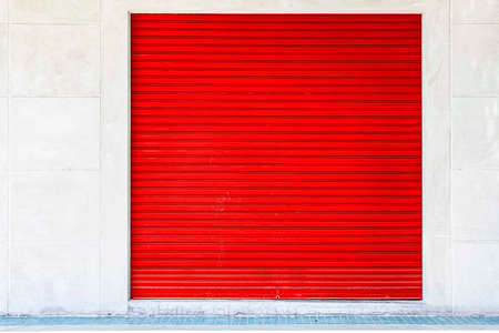 The red roller shutter door of the store is closed 版權商用圖片