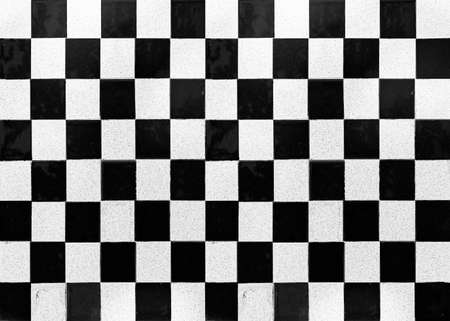 White and black checkered ceramic tiles pattern and background seamless Stock Photo