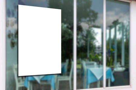 large blank billboard mounted on a restaurant glass