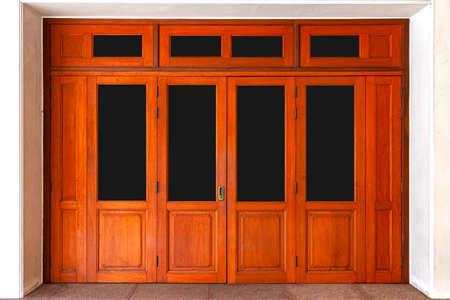 Large brown wooden door entrance to the building Standard-Bild
