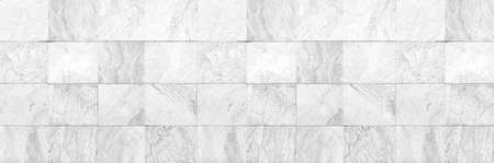 Panorama of White granite tiled wall with vintage pattern texture and background seamless