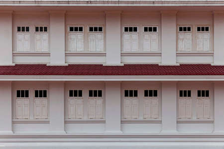 White wooden windows and ancient style two-story building