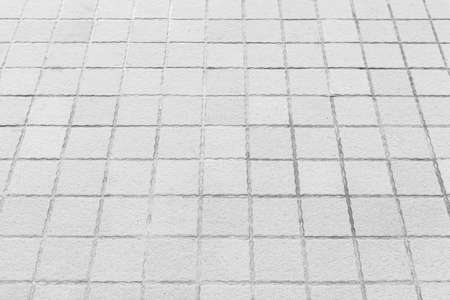 Perspective View Monotone white Brick Stone Pavement on The Ground for Street Road Standard-Bild