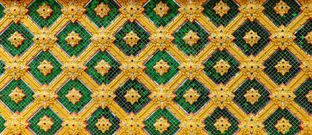 Panorama of Thai ancient style carved stone wall tile pattern and background seamless