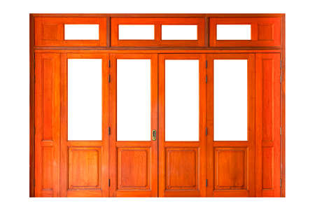 Large brown wooden door entrance to the building isolated on a white background
