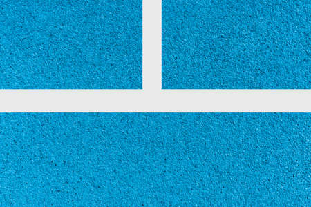 A close up of white lines running track