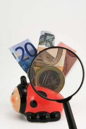 twenty two: photo of piggy bank full of euros on a white background