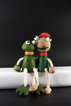 photograph of wooden puppets in the shape of a frog photo
