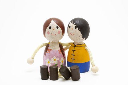 flowers boy: wooden dolls on white background Stock Photo