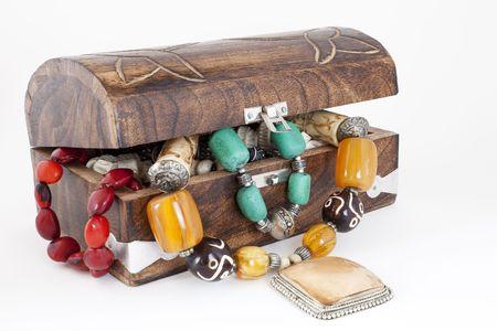 wooden jewelry box full of jewelry photo