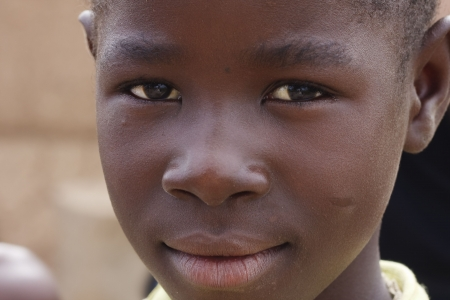 Gaoua,Burkina Faso - August 12,2009 : Child posing Lobi, the Lobi are warriors but also kind and hospitable. Editorial