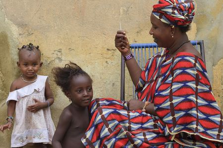 Mopti,Mali - August 16,2009 : African woman combing her daughters, usual practice in African culture. Stock Photo - 6886614