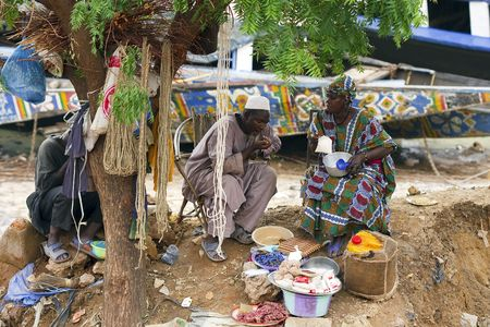 Mopti,Mali - August 16,2009 : Man and woman on the street selling, Mopti has the most important commercial port in the country, in the street you can buy everything.