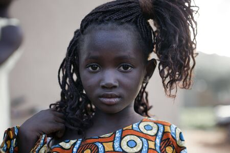 Tiebele,Burkina Faso - August 10,2009 : African girl, the gourounsi are a tribe living in Burkina Faso, near the border with Ghana, its capital is Tiebele. Stock Photo - 6886617