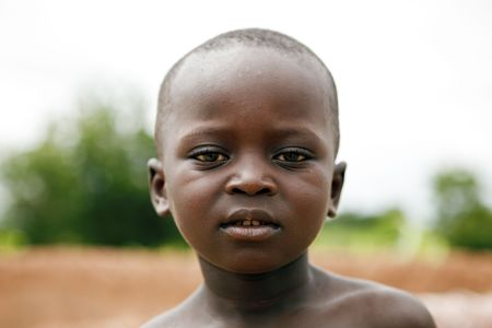 Gaoua,Burkina Faso - August 12,2009 : Child of the Lobi ethnic group, children living in remote villages of the city do not attend school for lack of means and resources. Editorial