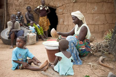 Gaoua,Burkina Faso - August 12,2009 : Women Lobi separating the grain, women are responsible for handling all foods.