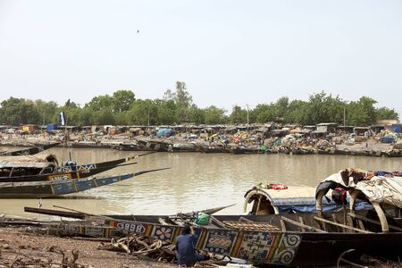 Mopti,Mali - August 16,2009 : Port of Mopti, the comings and goings of vessels is constant in the most important commercial port in Mali.