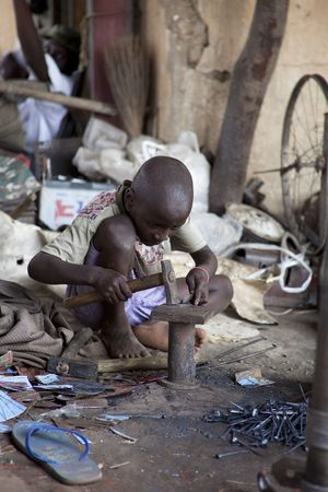 Mopti,Mali - August 16,2009 :  African Child work hard, forcing many children need to work from childhood in Mopti.