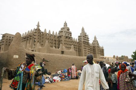 Djenne,Mali - August 17,2009 : Mosque of Djenne on market day, is held on Monday and is one of the most most important the country. Editorial
