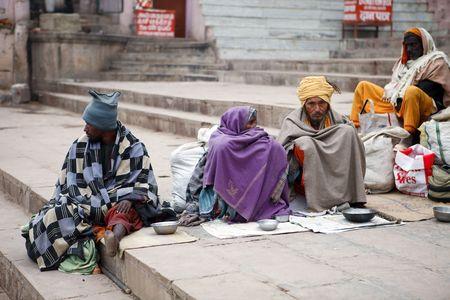 beggars: Varanasi,India - December 31,2009 : Beggars in Varanasi, hundreds of mutilated beggars by polio are on the streets of Varanasi. Editorial