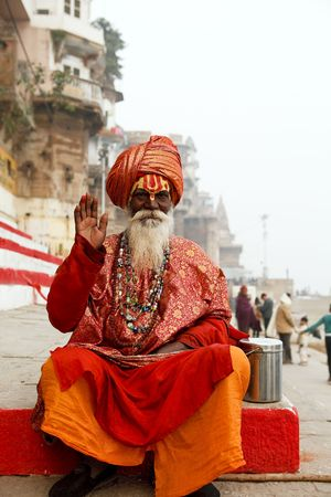 Varanasi,India - January 1,2010 : Sadhu in the river Ganges, a sadhu renunciation of all ties that unite with the earthly and material, and for the true values of life.