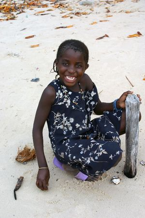 Carabane,Casamance,Senegal - February 18,2007 :  girl playing on the beach of Carabane, Carabane island is inhabited mainly by ethnic Diola. Stock Photo - 6886330