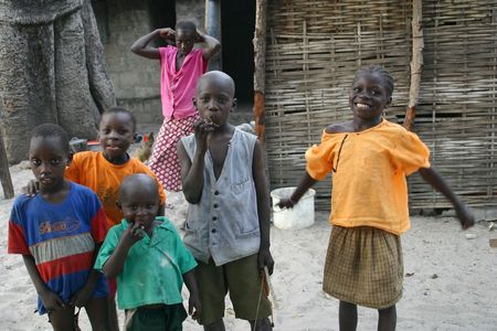 Carabane,Casamance,Senegal - February 18,2007 : Children Diola happy with the visit of the tourists, are scarce resources and tourism is an important source of revenue. Editorial