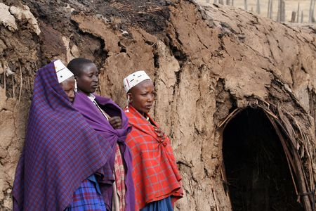 Ngorongoro,Tanzania - August 17,2007: Masai Women at the entrance of a house, the Masai are responsible for the care of their homes while the men bring to graze livestock. Stock Photo - 6886668