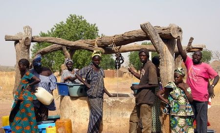 village man: Wassadou,Senegal - February 13,2007 : All the people working in the extraction of water from the well in the Peul ethnic village.