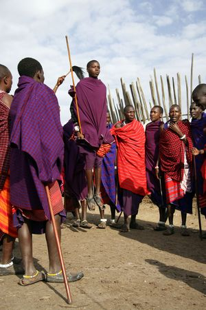Ngorongoro,Tanzania - August 18,2007 : Massai Warriors exhibits her dance before the visit of tourists, their main source of revenue today. Stock Photo - 6886677