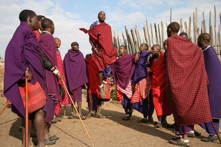 Ngorongoro,Tanzania - August 18,2007 : Massai Warriors exhibits her dance before the visit of tourists, their main source of revenue today. Stock Photo - 6886689