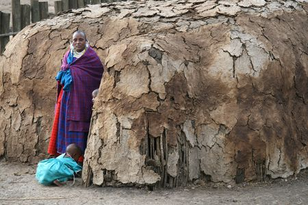 Ngorongoro,Tanzania - August 18,2007 : Masai Woman caring for their children outside his home, women are responsible for domestic work and childcare in the village. Stock Photo - 6886691