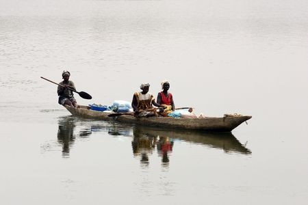 displacement: Country Bassari,Senegal - February 18 : Women navigating the Casamance River, part of the region remains awash most of the year promoting rice cultivation.