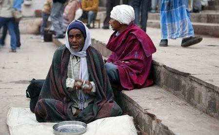 beggars: Varanasi,India - December 31,2009 : Beggar in Varanasi, thousands of beggars in the most disadvantaged castes living in the streets.