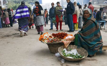 poverty in india: Varanasi,India - January 2,2010 : Selling flowers, the flowers are used daily in the ceremonies and offerings to the Ganges River.