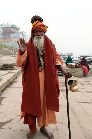 VARANASI - JANUARY 2: Sadhu in the river Ganges, a sadhu renunciation of all ties that unite with the earthly and material, and for the true values of life, January 2, 2010 in Varanasi, India
