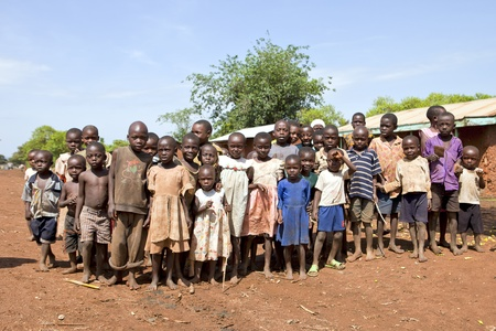 UGANDA - AUGUST 9: Children of the Karamojong ethnic look with curiosity, the Karamojong are in the process of disarmament, August 9, 2010 in Karamoja, Uganda