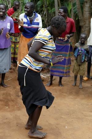 UGANDA-AUGUST 12: Karamojong ethnic woman dancing,live in northeastern Uganda, is currently in the process of disarmament, August 12, 2010 in Karamoja, Uganda  Stock Photo - 9144326