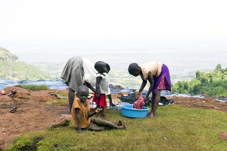 lack of water: UGANDA-AUGUST 8: Women doing the laundry in the river Sipi, lack of running water in homes forcing women to perform domestic chores in the rivers, August 8, 2010 in Kapchorwe District, Uganda