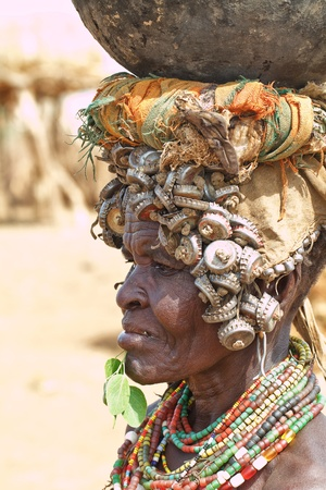 women of ethnic erbore, the erbore use anything as decoration, from bottle caps to locks and keys
