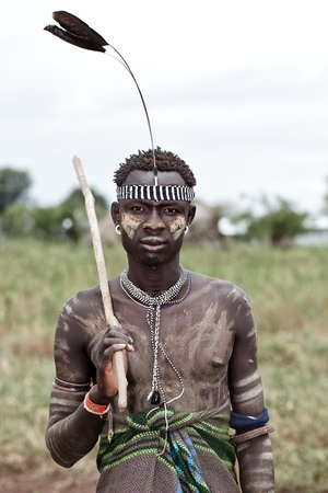 omo valley, ethiopian, august 11, 2011 - man of the mursi ethnic, ethnic omo valley may lose their livelihood with the construction of a hydroelectric dam.