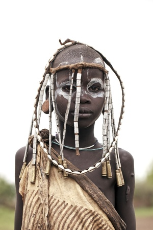 omo valley, ethiopian, august 11, 2011 - mursi girl ethnicity, ethnicity of the omo valley may lose their livelihood with the construction of a hydroelectric dam. Editorial