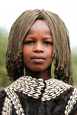 omo valley, ethiopian, august 10, 2011 - girl of ethnic tsemay, tsemay are the shepherds who inhabit the lower omo.